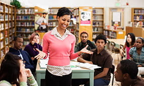 Woman Addressing Peers in Library